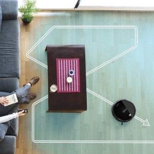 foto vista desde arriba de un salon y el sentido de la aspiradora en el suelo